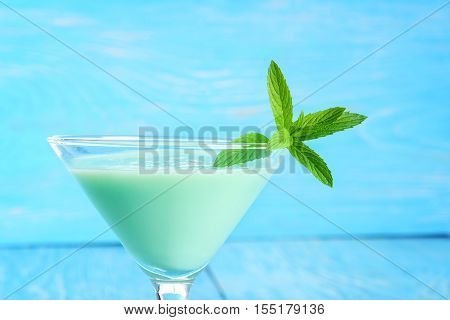 closeup grasshopper cocktail with mint with blue background
