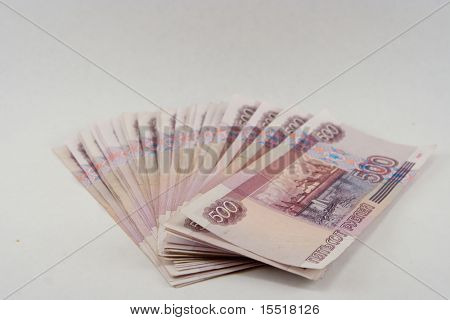 Pile of monetary denominations on a white background