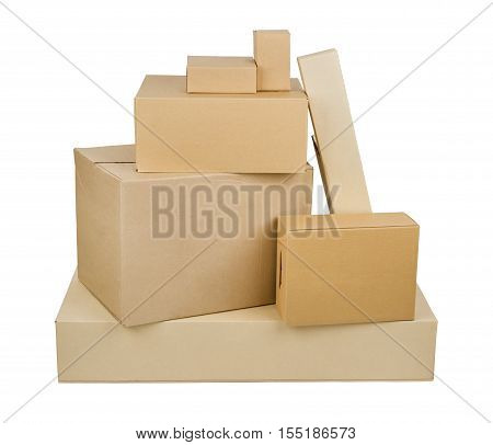 Pile of different size cardboard boxes isolated on white background