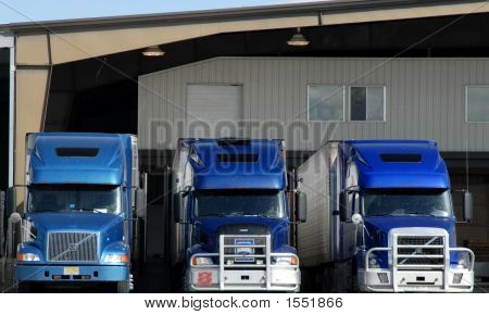 Blue Trucks At Loading Dock