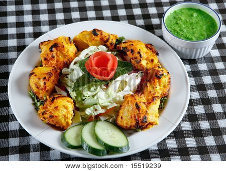 chicken tikka with salad in plate