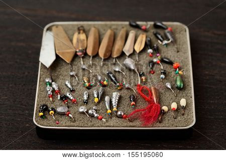 Set of old lures for ice fishing in tobacco box