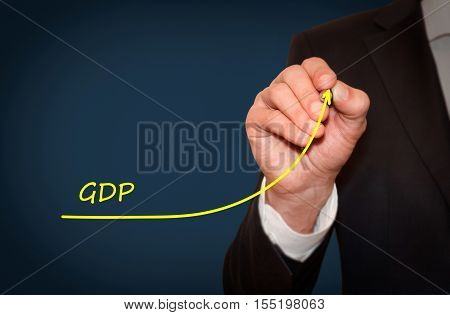 Businessman draw growing line symbolize growing GDP Gross Domestic Product