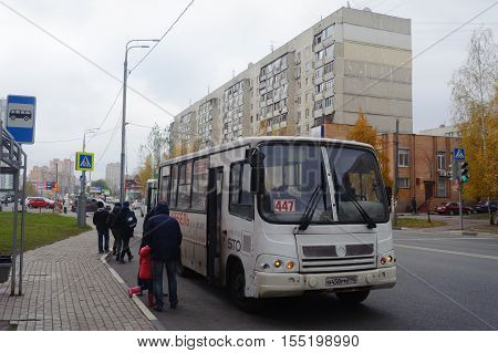 BALASHIKHA RUSSIA - OCTOBER 28: People entering the bus on Sverdlov Street on October 28 2016 in Balashikha. Balashikha is city in Moscow Oblast Russia located on Pekhorka River 1 kilometer east of Moscow.