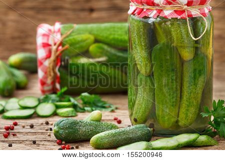 Fresh Cucumbers for pickling and marinated cucumbers in glass jars.