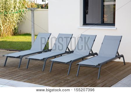 a lovely Sun beds beside swimming pool.