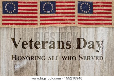 Veterans Day greeting USA patriotic old Betsy Ross flag and weathered wood background with text Veterans Day Honoring all who served