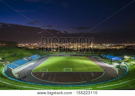 BELGOROD RUSSIA - MAY 08 2016: Stadium Belgorod State Technological University at night. Night cityscape.