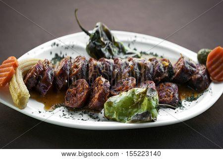 Portuguese spanish roast bbq grilled chourico chorizo spicy sausage tapas snack