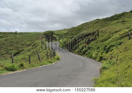 Country road on the grassy hills of Maui, Hawaii