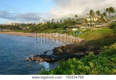 Tropical beach and resort at sunset in Wailea, Maui