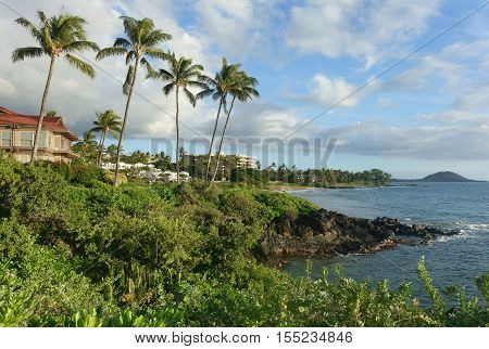 Maui rocky coastline with luxury condos and hotels