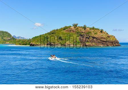 NACULA ISLAND, FIJI - AUGUST 24, 2012: Boat approaching Naviti Island part of the Yasawa Islands in Fiji