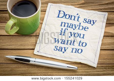 Don't say maybe if you want to say no - handwriting on a napkin with a cup of espresso coffee