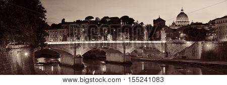 River Tiber and St Peters Basilica in Vatican City panorama at dusk