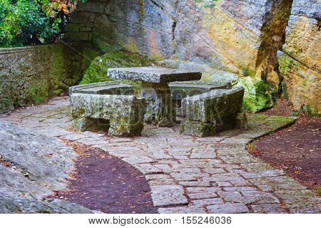 Stone arbor consisting of table and benches silent place anyone can relax in. San Marino Italy.