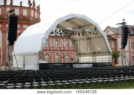 WIESBADEN, GERMANY - JULY 14: An established concert venue with rows of seats for a classical concert at the grounds of the castle Biebrich on July 14 2016 in Wiesbaden.