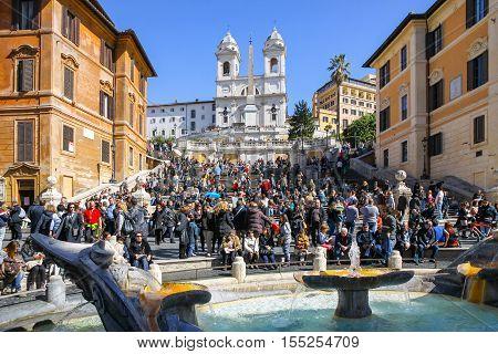 ROME ITALY - MARCH 9 2013: The Spanish Steps (Italian: Scalinata di Trinita dei Monti) are a set of steps in Rome Italy. Piazza di Spagna and fountain Fontana della Barcaccia on the foreground