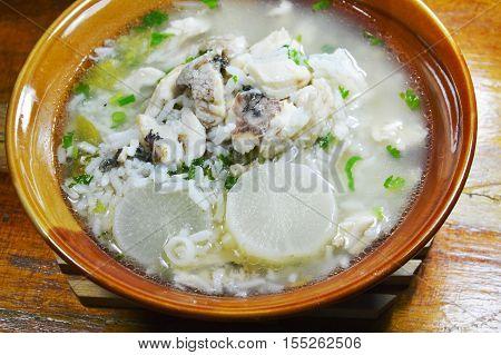 rice porridge with fish and radish hot soup on bowl