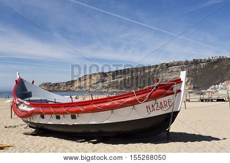 NAZARE, PORTUGAL - September 12, 2016: View of colourful fishing boats on the beach of the fishing village of Nazare Portugal