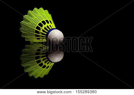 Yellow plastic shuttlecocks with blue strip isolated on black reflective background