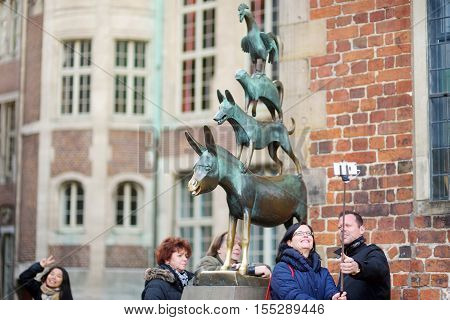 Bremen, Germany - March 23, 2016: Tourists Taking Pictures Of Themselves By Famous Statue In The Cen