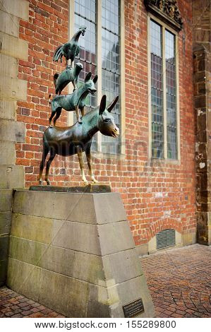 Bremen, Germany - March 23, 2016: Famous Statue In The Center Of Bremen, Known As The Bremen Town Mu