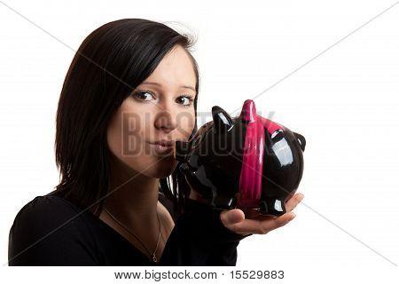 Young Woman Piggy Bank Kiss Closeup