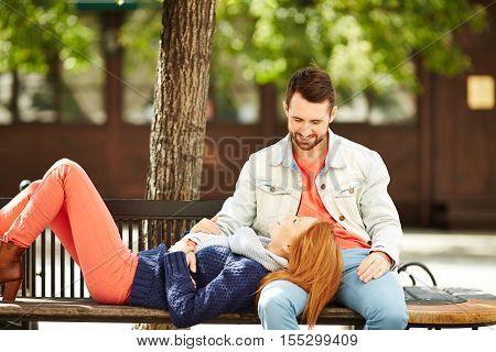 Girl lying in boyfriends lap in park