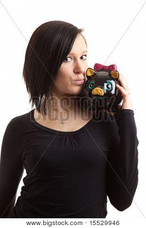 Young Woman Piggy Bank Shoulder Kiss