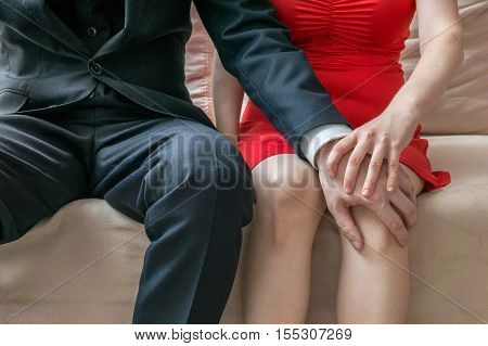 Harassment at workplace. Manager is touching knee of his secretary.