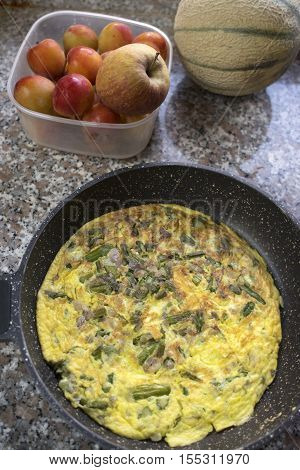 freshly cooked omelette with asparagus in pan. flat lay