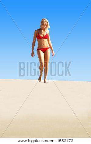 Lady In Red Bikini Strolling Along Beach
