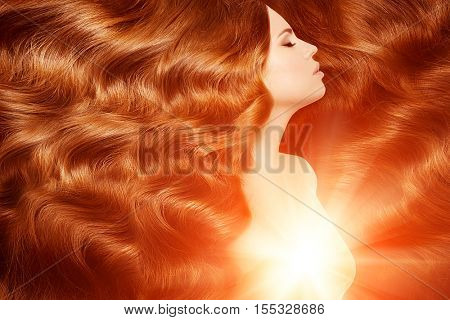 Model with long red hair. Waves Curls Hairstyle. Hair Salon. Updo. Fashion model with shiny hair. Woman with healthy hair girl with luxurious haircut. Hair loss Girl with hair volume.