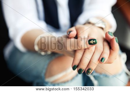 Stylish Girl Sitting In Torn Jeans And Modern Green Nail Polish, Watch, Bracelet. Fashion, Lifestyle