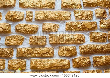 texture of old gilded wall ornamental stone.