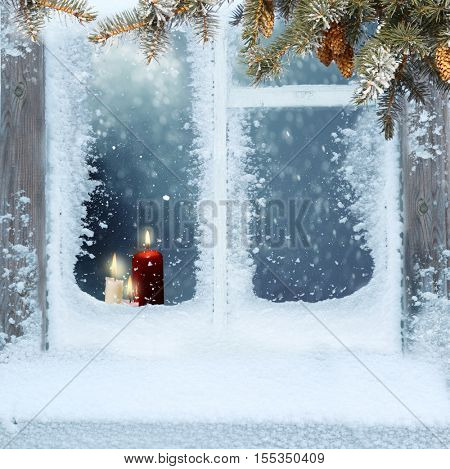 Frosted window with Christmas decoration.Merry Christmas and happy New Year greeting card with copy-space.Christmas background.