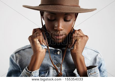 Closeup Of Black Woman Wears Hat And Jeans Jacket