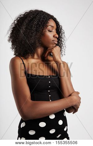 Black Woman Watching Aside With Big Afro Hair