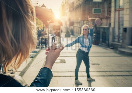Shot Of A Girl Photographer Taking A Photo Of A Her Friend