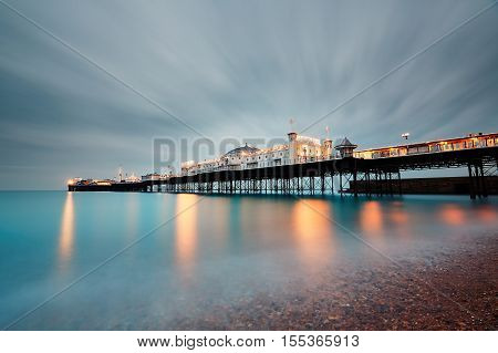 BRIGHTON UK - OCTOBER 24 2016: Brighton Marine Palace and Pier is popular tourist attraction which opened in 1899. Brighton in United Kingdom at dusk on October 24 2016.