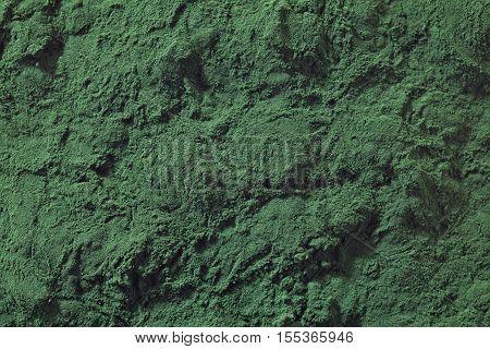 Green bakcground full of spirulina algae powder
