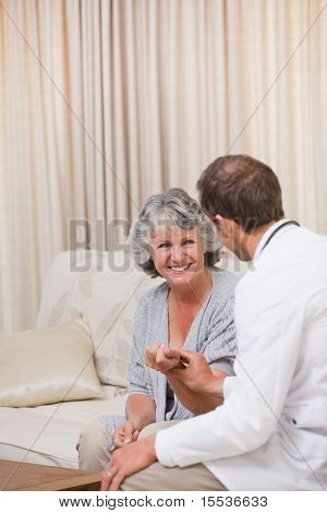Doctor talking with his patient at home