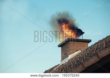 House chimney with some fire coming out it.