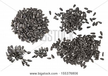 Closeup of black sunflower seeds isolated on white background with clipping path