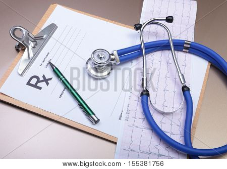 Stethoscope Head And Silver Pen Lying On Cardiogram  Clipboard Pad. Cardio Therapeutist Assistance,