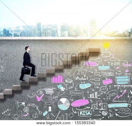 Side view of young businessman climbing ladder with creative business sketch drawn underneath on concrete wall with city view. Success concept