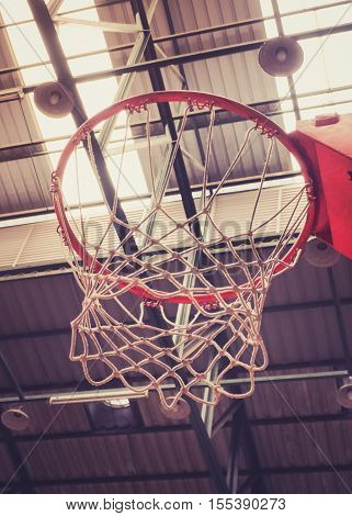 Close up of Basketball Hoop in Sport Hall, Retro color filter