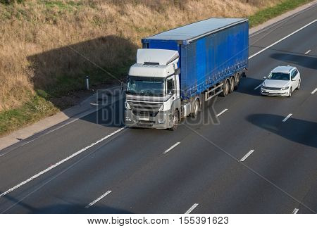 Articulated lorry in motion on the motorway