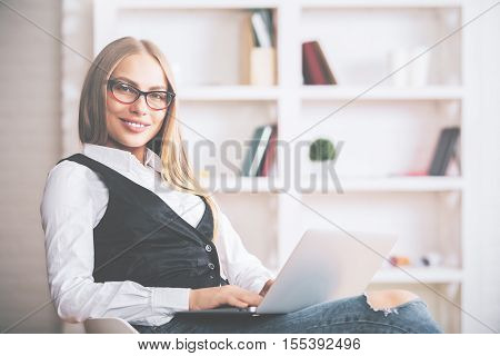 Smiling Woman Using Notebook